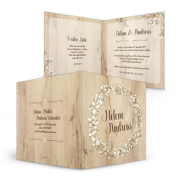 Einladung zur Hochzeit mit hellem Holz und Schleierkraut Kranz