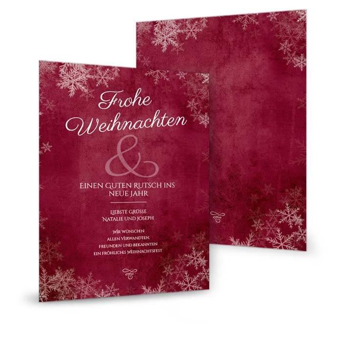 Rote Weihnachtskarte mit Schneeflocken