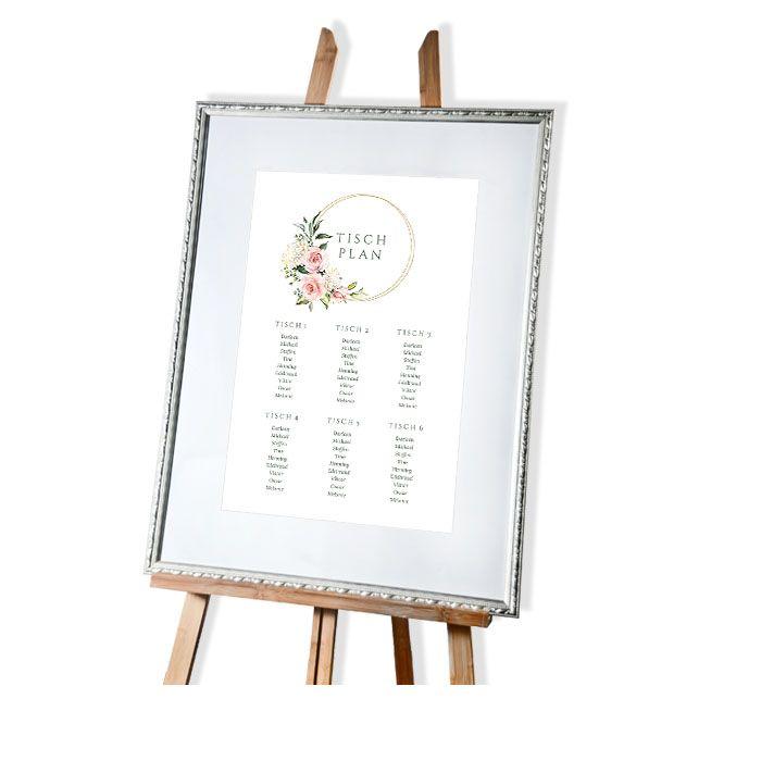Großer Tischplan zur Hochzeit mit Goldreif und Blumen in Rosa