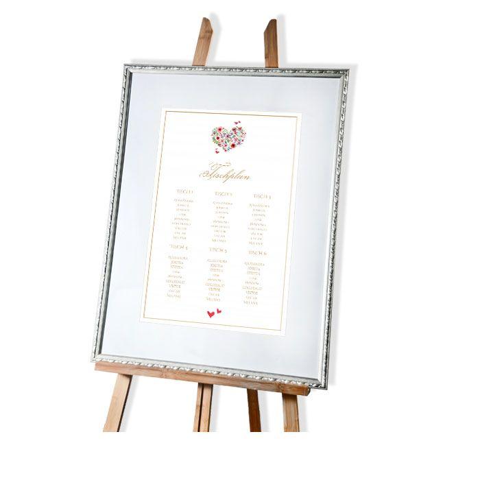 Großer Tischplan zur Hochzeit mit Herz aus bunten Blüten