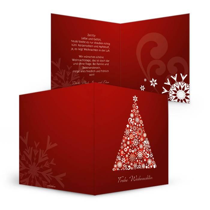 Rote Weihnachtskarte mit Baum aus Kristallen und Kugeln