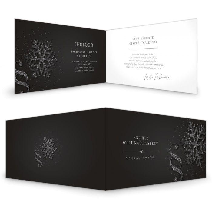 Weihnachtskarte für Rechtsanwälte mit Paragraphen Symbol und Eiskristall in Schwarz